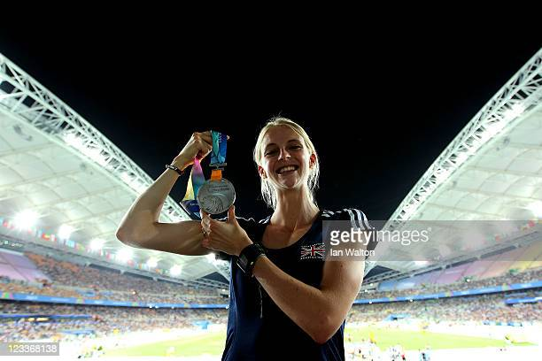 Hannah England of Great Britain poses with her silver medal for the women's 1500 metres during day seven of 13th IAAF World Athletics Championships...