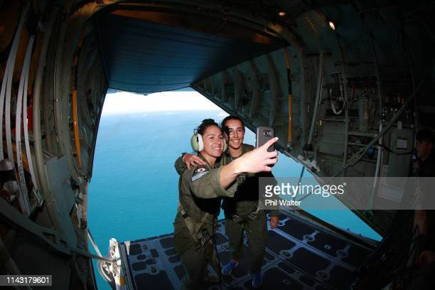 Hannah Evans from Palmerston North and load master Callie Lucas stand on the back of the C130 Hercules above the Marlborough Sounds on April 17 2019...