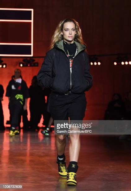 Hannah Ferguson walks the runway at the TommyNow show during London Fashion Week February 2020 at the Tate Modern on February 16, 2020 in London,...