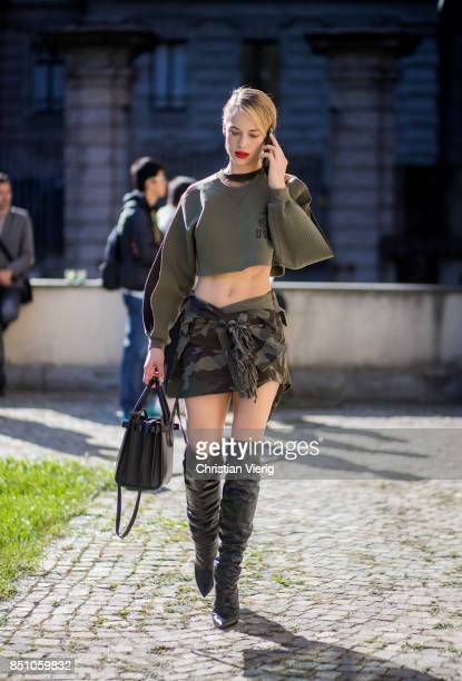 Hannah Ferguson wearing US Army cropped top camouflage skirt boots is seen outside Max Mara during Milan Fashion Week Spring/Summer 2018 on September...