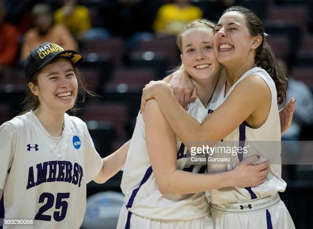 Hannah Fox Emma McCarthy and Cam Hendricks of Amherst College celebrated with the team after winning the Division III Women's Basketball Championship...