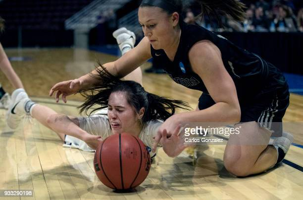 Hannah Fox of Amherst College and Lauren Petit of Bowdoin fought for a loose ball during the Division III Women's Basketball Championship held at the...