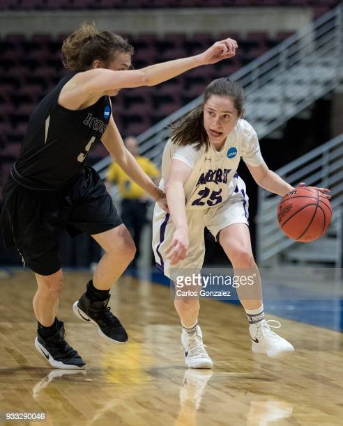 Hannah Fox of Amherst College dribbles past Kate Kerrigan of Bowdoin during the Division III Women's Basketball Championship held at the Mayo Civic...