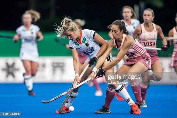Hannah Gablac of Germany challenges for the ball with Julieta Jankunas of Argentina during the Women's FIH Field Hockey Pro League match between...