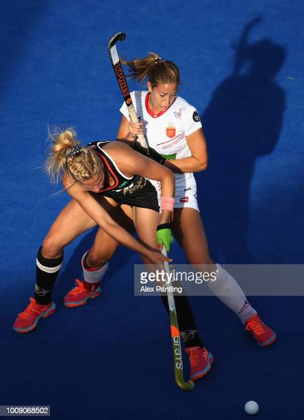 Hannah Gablac of Germany holds off Maria Lopez of Spain during the quarter final game between Germany and Spain of the FIH Womens Hockey World Cup at...
