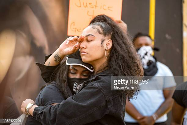 Hannah Gebresilassie and Qri Montague embrace before joining other people marching through the streets after the verdict was announced for Derek...