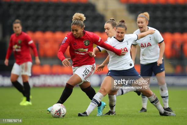 Hannah Godfrey of Tottenham Hotspur in action with Lauren James of Manchester United during the Barclays FA Women's Super League match between...