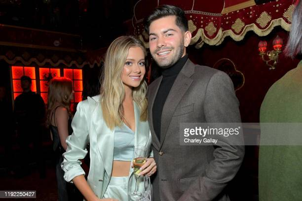 Hannah Godwin and Dylan Barbour attend Lancôme x Vogue L'Absolu Ruby Holiday Event at Raspoutine on December 05 2019 in West Hollywood California