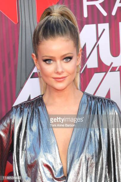 Hannah Godwin arrives at the 2019 iHeartRadio Music Awards which broadcasted live on FOX at Microsoft Theater on March 14 2019 in Los Angeles...