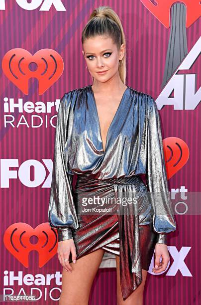 Hannah Godwin attends the 2019 iHeartRadio Music Awards which broadcasted live on FOX at Microsoft Theater on March 14 2019 in Los Angeles California