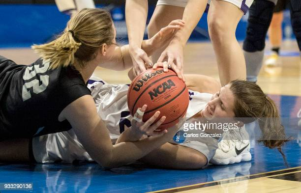 Hannah Graham of Bowdoin and Madeline Eck of Amherst College fought the ball during the Division III Women's Basketball Championship held at the Mayo...