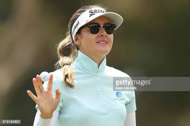 Hannah Green of Australia acknowledges the crowd after holing a putt on the 18th hole during day three of the ISPS Handa Australian Women's Open at...