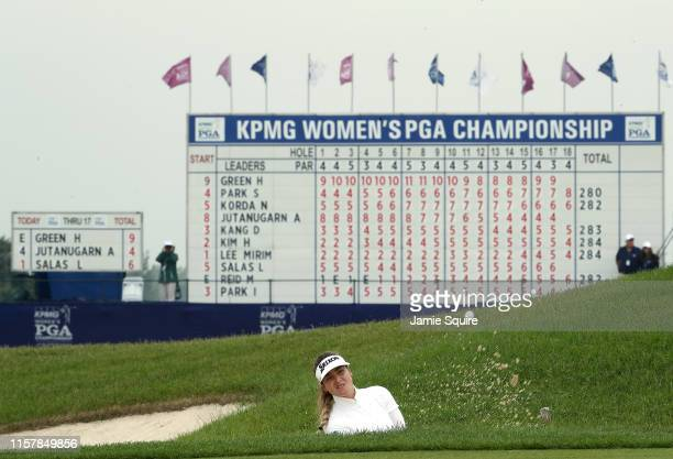 Hannah Green of Australia blasts from a bunker for her third shot on the 18th hole during the final round on her way toward winning the KPMG Women's...
