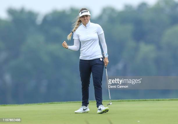 Hannah Green of Australia celebrates holing a putt for a crucial birdie on the par 4 16th hole during the final round of the 2019 KPMG Women's PGA...