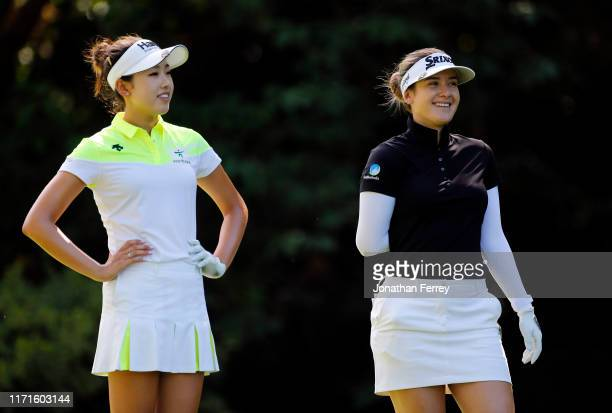 Hannah Green of Australia chats with Yealimi Noh hits on the 5th hole during the final round of the LPGA Cambia Portland Classic at Columbia...