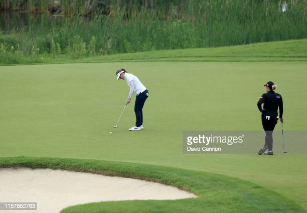 Hannah Green of Australia hits a putt on the par 4 10th hole watched by Ariya Jutanugarn of Thailand during the final round of the 2019 KPMG Women's...