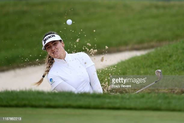 Hannah Green of Australia hits from a green side bunker on the 18th green during the final round of the KPMG PGA Championship at Hazeltine National...