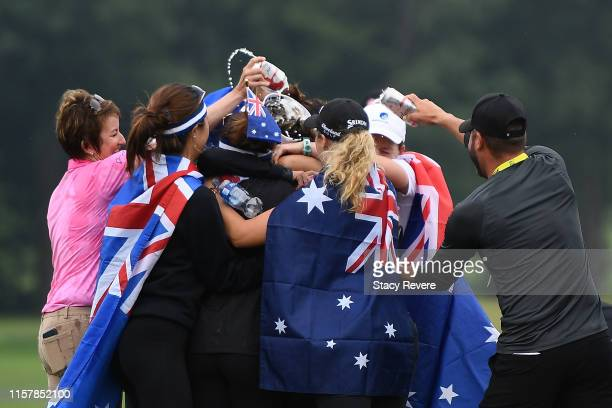 Hannah Green of Australia is congratulated by friends on the 18th green after winning the KPMG PGA Championship at Hazeltine National Golf Club on...