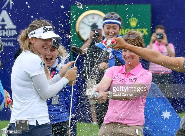 Hannah Green of Australia is congratulated by Karrie Webb of Australia after her one shot victory in the final round of the 2019 KPMG Women's PGA...