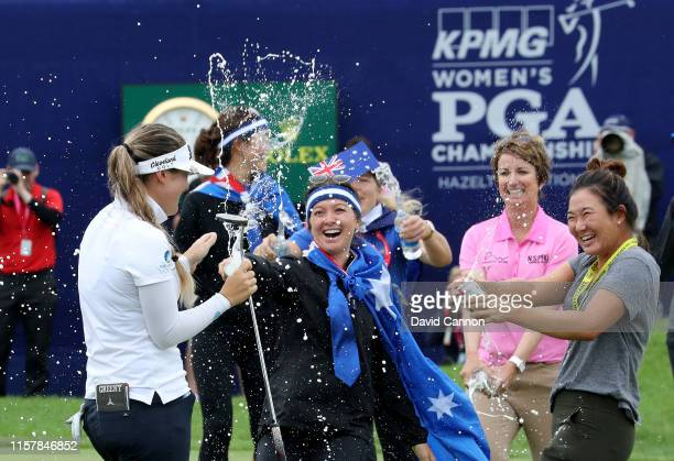 Hannah Green of Australia is congratulated by Karrie Webb of Australia and others after her one shot victory in the final round of the 2019 KPMG...