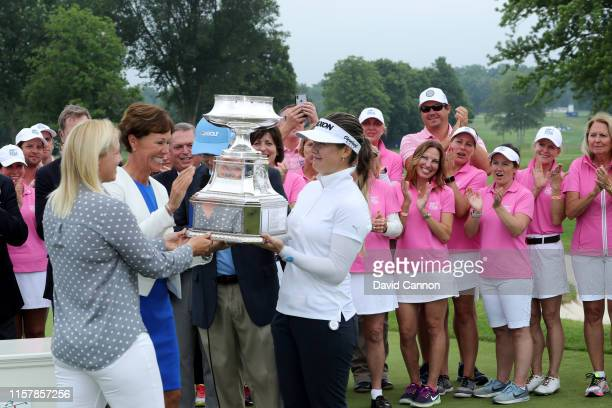 Hannah Green of Australia is presented with the trophy at the official prizegiving after her one shot victory in the final round of the 2019 KPMG...