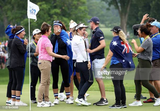 Hannah Green of Australia is swarmed by friends on the green after winning the KPMG Women's PGA Championship at Hazeltine National Golf Course on...