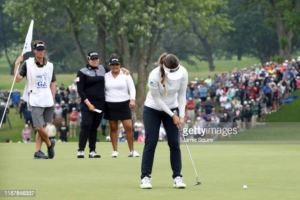 Hannah Green of Australia makes her final putt on the 18th green to win the KPMG Women's PGA Championship at Hazeltine National Golf Course on June...
