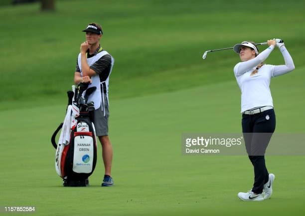 Hannah Green of Australia plays her third shot on the par 5 11th hole watched by her caddie Nate Blasko during the final round of the 2019 KPMG...