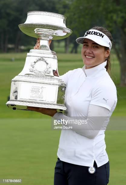 Hannah Green of Australia poses with the trophy after winning the KPMG Women's PGA Championship at Hazeltine National Golf Course on June 23 2019 in...