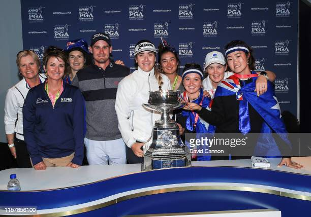 Hannah Green of Australia poses with the trophy and a number of other Australian friends and supporters after her one shot victory in the final round...