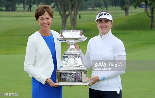 Hannah Green of Australia poses with the trophy and PGA of America President Suzie Whaley after her one shot victory in the final round of the 2019...