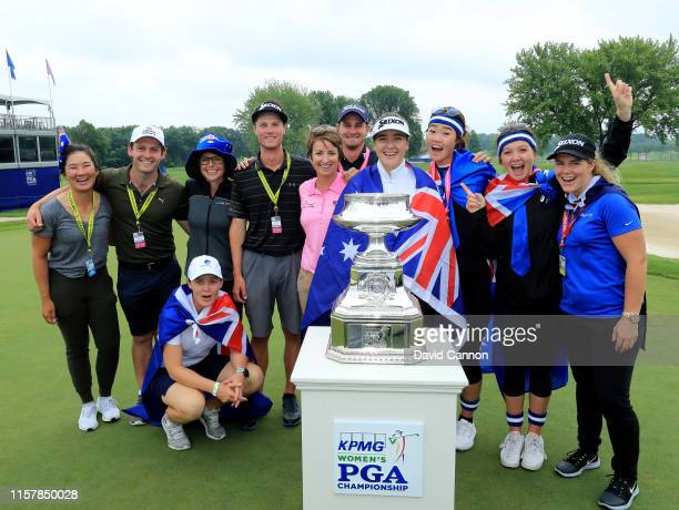 Hannah Green of Australia poses with the trophy with Karrie Webb her caddie Nate Blasko and a number of other Australian friends and supporters after...