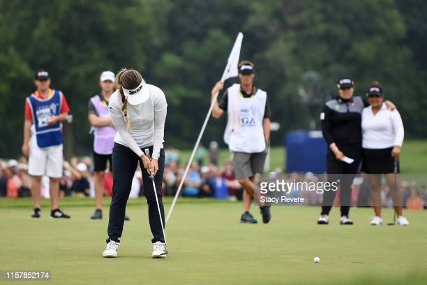 Hannah Green of Australia putts for par on the 18th green during the final round of the KPMG PGA Championship at Hazeltine National Golf Club on June...