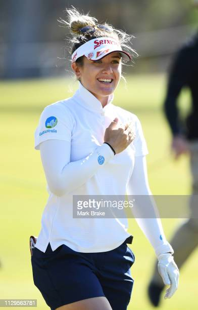 Hannah Green of Australia taps her heart as she watches her approach to the 18th land during day one of the 2019 ISPS Handa Women's Australian Open...