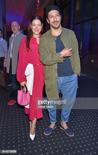 Hannah Herzsprung and Fahri Yardim attend the 'Steig Nicht Aus' Premiere on April 9 2018 in Berlin Germany