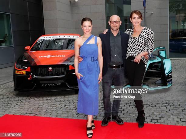 Hannah Herzsprung Juergen Vogel and Anja Kling attend the Jaguar IPACE eTrophy Event at Britische Botschaft on May 23 2019 in Berlin Germany