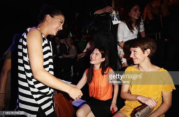 Hannah Herzsprung Nora von Waldstaetten and Julia Koschitz sit in front row at the Strenesse Blue Show during MercedesBenz Fashion Week Berlin...