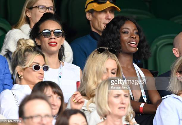 Hannah John-Kamen and AJ Odudu attend Wimbledon Championships at All England Lawn Tennis and Croquet Club on July 01, 2021 in London, England.
