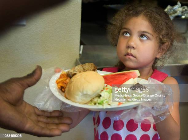Hannah Jones makes eye contact as she hands out food to those in need at the Southwest Community Center in Santa Ana Her great great grandma Annie...
