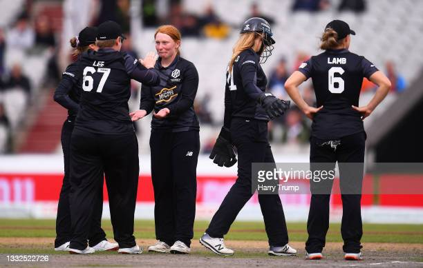 Hannah Jones of Manchester Originals Women celebrates after taking the wicket of Anya Shrubsole of Southern Brave Women with team mate Lizelle Lee...
