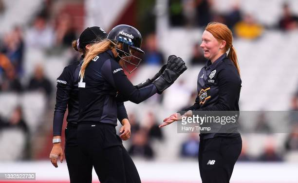 Hannah Jones of Manchester Originals Women celebrates after taking the wicket of Anya Shrubsole of Southern Brave Women with team mate Ellie...