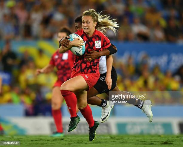 Hannah Jones of Wales is tackled by Miriama Naiobasali of Fiji during the Rugby Sevens Women's Pool B match between Fiji and Wales on day nine of the...