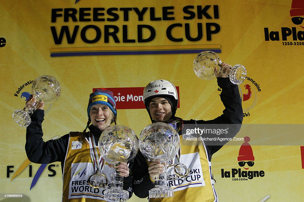 Hannah Kearney of the USA wins the Overall Freestyle World Cup globe and Mikael Kingsbury of Canada wins the Overall Freestyle World Cup globe during the FIS Freestyle Ski World Cup Men's and Women's Dual Moguls on March 21, 2014 in La Plagne, France.