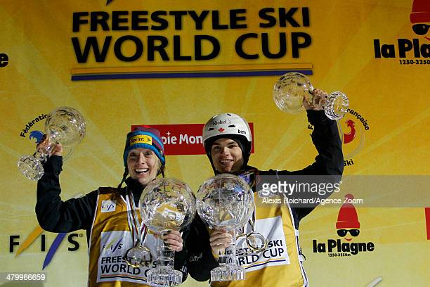 Hannah Kearney of the USA wins the Overall Freestyle World Cup globe and Mikael Kingsbury of Canada wins the Overall Freestyle World Cup globe during...