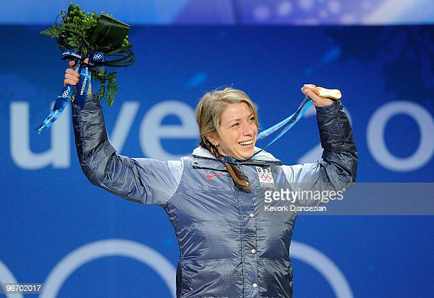 Hannah Kearney of United States celebrates with her gold medal during the medal ceremony for the Ladies Moguls final medal ceremony on day 3 of the...