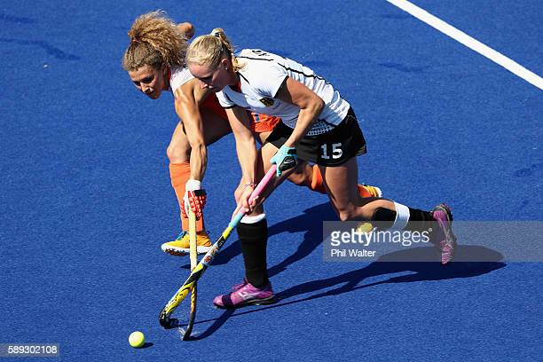 Hannah Kruger of Germany and Maria Verschoor of the Netherlands contest the ball in the Women's Pool A match between Germany and the Netherlands on...