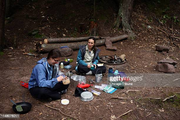 Hannah Lindquist left and her sister Rebecca both of Plymouth Minn enjoy a dinner of rice beans and textured vegatible protein while camping at the...