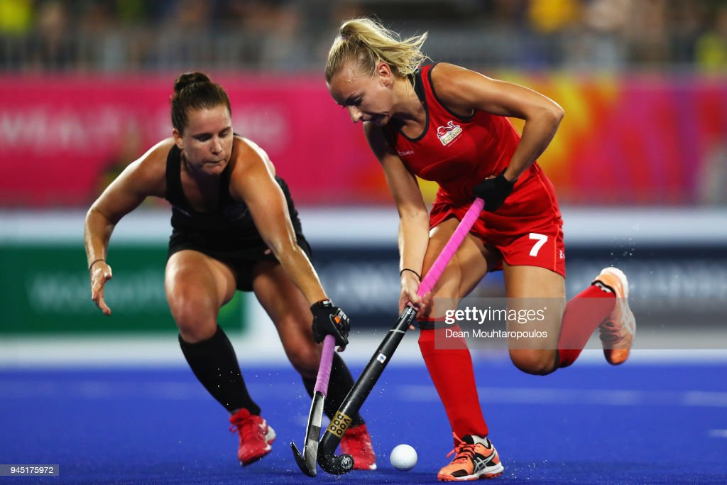 Hannah Martin of England battles for the ball with Ella Gunson of New Zealand during Women's Semifinal hockey match between England and New Zealand on day eight of the Gold Coast 2018 Commonwealth Games at Gold Coast Hockey Centre on April 12, 2018 on the Gold Coast, Australia.