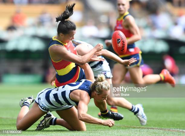 Hannah Martin of the Adelaide Crows handballs over Renee Garing of the Cats during the AFLW Preliminary Final match between the Adelaide Crows and...