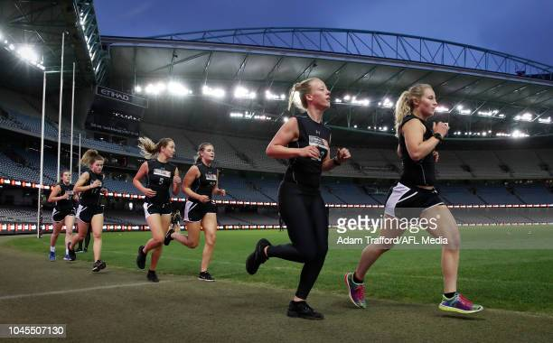 Hannah McLaren and Nikki Gore perform in the 2km time trial during the AFLW Draft Combine at Marvel Stadium on October 3 2018 in Melbourne Australia